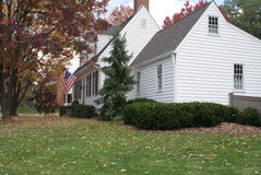 White colonial home in autumn Stock Images