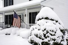 Free White Colonial Home In Snow Storm Stock Images - 112777384