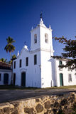 White colonial style church. Traditional white colonial style church with blue sky background, Paraty town, Costa Verde, Brazil Stock Photos