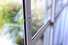 Aluminum and glass window door. White color aluminum and glass window door royalty free stock image