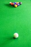 White and color balls on pool table stock photography