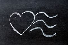 White color chalk drawing as heart shape with postrmark