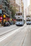 White color Double decker tram on a busy street in Sheung Wan district of Hong Kong Island, symbol of HK; Hong Kong, China, 16. December 2018 stock photos