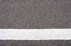 White color painted on the asphalt road Stock Images