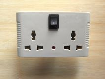 Wireless surge protector with sockets. White color 3 pin wireless surge protector with two sockets, switch and LED light stock images