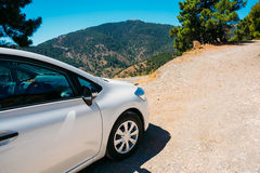 White color small hatchback car on Spainish nature Royalty Free Stock Photography