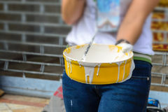 White color in yellow bucket for paint wall with paint roller Stock Photos