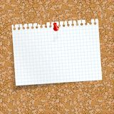 White colored checkered scrap of paper with pin needle. Stock Photos