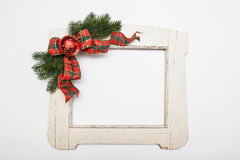 White colored christmas decorated wooden frame isolated on white Stock Image