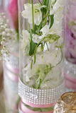 White colored delphinium close up. White colored delphinium flowers on a table in a glass flask. wedding table decoration close up Royalty Free Stock Images