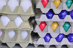 White and Colored easter eggs Stock Photos