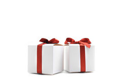 White colored gift boxes with red ribbons isolated Stock Image