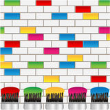 White and coloured bricks and brushes Stock Images