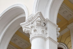White columns with arches on the facade of the building.  Stock Photo