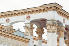 White columns on the facade of the building in classical style Stock Photos