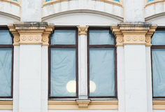 White columns on the facade of the building in classical style.  Stock Photography