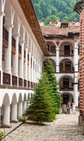 White columns in the Rila Monastery in Bulgaria Stock Photos