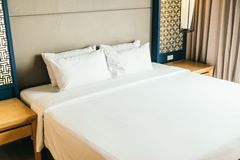 Pillow on bed. White comfortable pillow on bed decoration in hotel bedroom interior stock photos