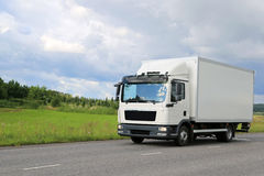 White Commercial Delivery Truck on the Road Stock Photo