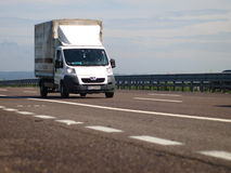 White commercial Peugeot van. Logistic commercial van from eastern europe on italian motorway stock image