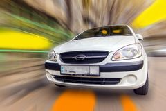 Compact car Hyundai. White compact car Hyundai on a blurred background in motion Royalty Free Stock Photos