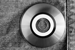 White compact disc within pocket. Jeans style Stock Photo