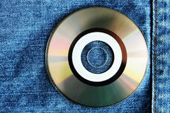 White compact disc within pocket. Jeans style Royalty Free Stock Photo
