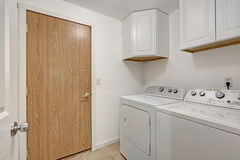 White compact laundry room with washing machine and dryer. Stock Image