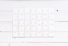 White completed puzzle on white wooden table Stock Image