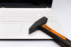 White computer with hard reset hammer on the keyboard Royalty Free Stock Photo