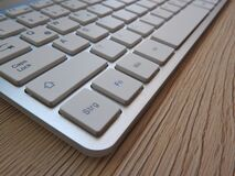 White Computer Keyboard on Brown Wooden Table Royalty Free Stock Images