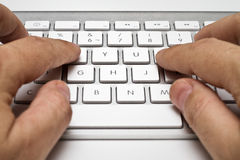 White computer keyboard with hands Royalty Free Stock Image