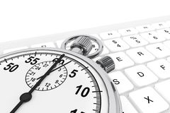 White computer keyboard with stopwatch Stock Photos