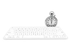 White computer keyboard with stopwatch Stock Photo