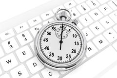White computer keyboard with stopwatch Stock Images