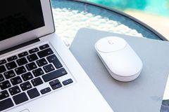 White computer mouse on the keyboard. Place for logo and text. royalty free stock photo
