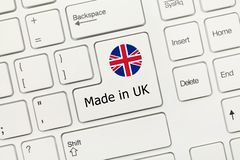 White conceptual keyboard - Made in UK key with flag. Close-up view on white conceptual keyboard - Made in UK key with flag royalty free stock photo