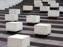 White Concrete Blocks on dark Granite Steps Stock Photo