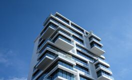 White Concrete Building Under Sunny Blue Sky royalty free stock image