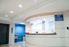 Photo of a hospital beautiful reception. White concrete counter stand of an hospital beautiful reception royalty free stock photo