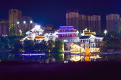 White Concrete House Beside Large Body of Water during Nightime Royalty Free Stock Images