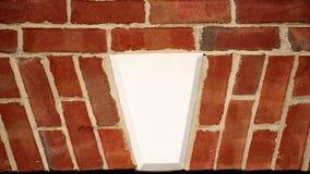A keystone surrounded red brick. royalty free stock photo