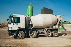 White concrete mixer vehicle on the construction site Stock Image