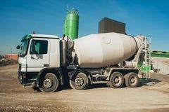 White concrete mixer vehicle on the construction site. Construction aggregate dumps Stock Image