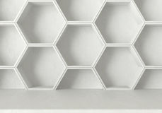 White concrete table and hexagons shelf background, 3D rendering Stock Image