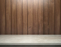 White concrete table with wooden plank wall Royalty Free Stock Images