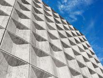 White concrete wall under cloudy sky Stock Photo
