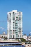 White Condo Building in Puerto Rico on Blue Sky Stock Photo