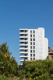 White Condo Tower with Sunflowers in foreground Royalty Free Stock Photography