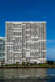 White Condo Under Blue Sky Over Surf Stock Photography